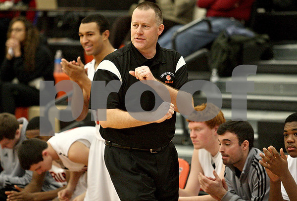 Monica Maschak - mmaschak@shawmedia.com<br /> DeKalb's Head Coach David Rohlman reacts to his team in overtime during a Chuck Dayton tournament game against Geneseo on Friday, December 27, 2013. The Barbs won, 73-69.