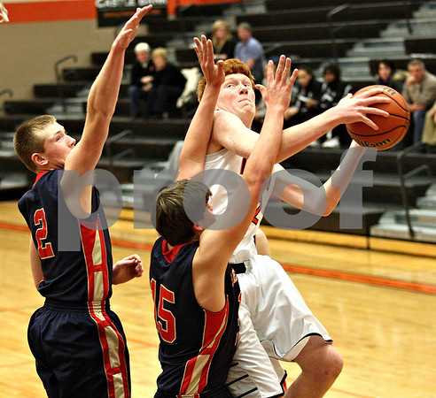 Monica Maschak - mmaschak@shawmedia.com<br /> DeKalb's Micah Fagerstrom attempts a shot in the first quarter against Belvidere during the first day of the Chuck Dayton Tournament on Saturday, December 21, 2013. DeKalb won, 72-68.