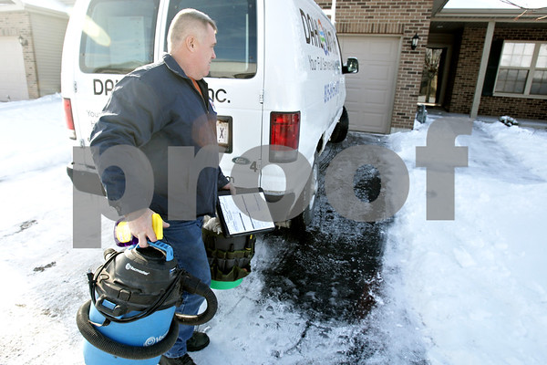 Rob Winner – rwinner@shawmedia.com<br /> <br /> Johnnie Smith of Dahlquist Inc., Heating and Cooling arrives at a residence to perform preventative maintenance on a furnace and to check a fireplace in Sycamore, Ill., Monday, Dec. 23, 2013.