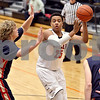 Monica Maschak - mmaschak@shawmedia.com<br /> DeKalb's Luke Davis III passes the ball in the second quarter against Belvidere during the first day of the Chuck Dayton Tournament on Saturday, December 21, 2013. DeKalb won, 72-68.