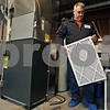 Rob Winner – rwinner@shawmedia.com<br /> <br /> Johnnie Smith of Dahlquist Inc., Heating and Cooling replaces a filter while servicing a furnace at home in Sycamore, Ill., Monday, Dec. 23, 2013.