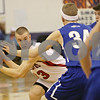 Rob Winner – rwinner@shawmedia.com<br /> <br /> Indian Creek's David Boehne (33) looks to pass while being pressured by two Rockford Christian defenders in the second quarter during their game at the Plano Christmas Classic on Monday, December 23, 2013. RC defeated IC, 36-35.