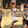 Monica Maschak - mmaschak@shawmedia.com<br /> DeKalb's Rudy Lopez attempts two points in the fourth quarter against Belvidere during the first day of the Chuck Dayton Tournament on Saturday, December 21, 2013. DeKalb won, 72-68.