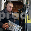 Rob Winner – rwinner@shawmedia.com<br /> <br /> Johnnie Smith of Dahlquist Inc., Heating and Cooling removes the burners from a furnace while performing maintenance on the unit while on a service call at a home in Sycamore, Ill., Monday, Dec. 23, 2013.