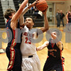 Monica Maschak - mmaschak@shawmedia.com<br /> DeKalb's Luke Davis III makes a shot in the third quarter against Belvidere during the first day of the Chuck Dayton Tournament on Saturday, December 21, 2013. DeKalb won, 72-68.