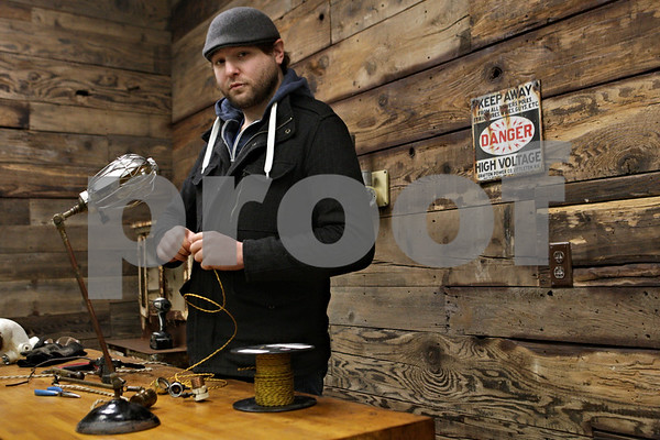 Rob Winner – rwinner@shawmedia.com<br /> <br /> Nathan Rock of Industrial Artifacts is seen at his shop in DeKalb on Friday, Dec. 20, 2013.