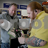 Monica Maschak - mmaschak@shawmedia.com<br /> Asset Protection Lead Kevin Carpenter (right) tags items customer Matt Beckman brings back for exchanging at Best Buy in DeKalb on Thursday, December 26, 2013.