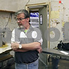 Rob Winner – rwinner@shawmedia.com<br /> <br /> Village President Les Bellah looks around what was once the butcher shop inside the former Kirkland Super Market on Thursday, Dec. 19, 2013. The village has purchased the building, which was vacant for a couple of years, and plans to redevelop it using tax increment financing.