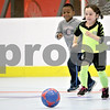 Monica Maschak - mmaschak@shawmedia.com<br /> Philomena Wiesner and Ryan Mason go one-on-one during a holiday soccer camp held at the Kishwaukee YMCA on Thursday, December 26, 2013. The camp serves children between first and third grade.