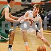 Monica Maschak - mmaschak@shawmedia.com<br /> DeKalb's Michael Pollack dribbles into the paint in the second quarter of a Chuck Dayton tournament game against Geneseo on Friday, December 27, 2013. The Barbs won, 73-69.