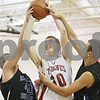 Rob Winner – rwinner@shawmedia.com<br /> <br /> Indian Creek's Garrett Post (30) is able to put up two points while being defended by Hinckley-Big Rock's Jason Bohannon (left) and fouled by Tyler Runge (right) during the third quarter of a tournament game at the Plano Christmas Classic on Monday, December 30, 2013.  Post also made his free throw shot to complete a 3-point play. IC defeated H-BR, 61-37.