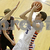 Rob Winner – rwinner@shawmedia.com<br /> <br /> Genoa-Kingston's Tommy Lucca takes a shot over Forreston's Nathan Schneiderman in the third quarter during a tournament game at the Plano Christmas Classic on Saturday, Dec. 28, 2013. G-K defeated Forreston, 43-42.