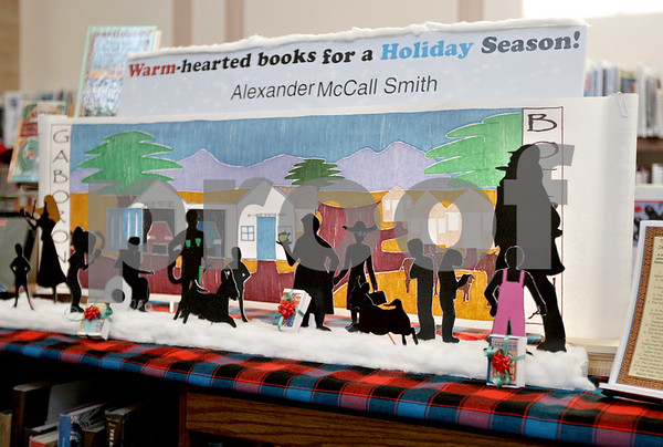 Monica Maschak - mmaschak@shawmedia.com<br /> Librarians set up holiday display based on the books of Alexander McCall Smith for a contest to bring the author to DeKalb Library on Thursday, January 2, 2014. The winner will not be announced until February.