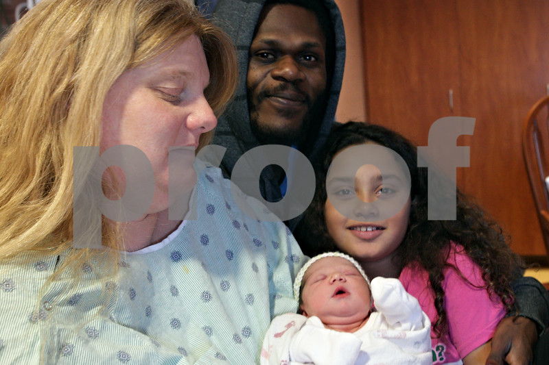 Rob Winner – rwinner@shawmedia.com<br /> <br /> Amy Jo Park (left to right), Maurice Patterson and Deanna Park, 10, pose for a photograph with newborn Miranda Mae Patterson at Valley West Hospital in Sandwich, Ill., Thursday, January 2, 2014. Miranda Mae was born at 9:53 a.m. and weighed 7 pounds and 1 ounce. Deanna Park, Miranda Mae's sister, was born January 1, 2004.