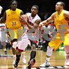 Monica Maschak - mmaschak@shawmedia.com<br /> Northern Illinois' Travon Baker passes the ball in the first half against Bethune-Cookman on Friday, January 3, 2014. The Huskies beat the Wildcats, 65-51.