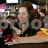 Rob Winner – rwinner@shawmedia.com<br /> <br /> Jeanann Sundby begins decorating O'Leary's Restaurant and Pub ahead of Tuesday night's New Year's party in DeKalb, Ill.