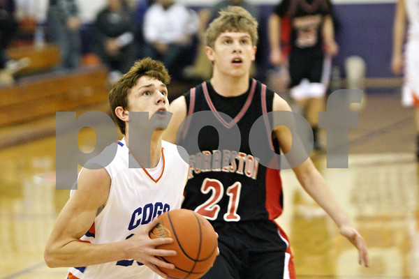 Rob Winner – rwinner@shawmedia.com<br /> <br /> After a steal, Genoa-Kingston's Ian Fell puts up two points with a layup in the second quarter during a tournament game against Forreston at the Plano Christmas Classic on Saturday, Dec. 28, 2013. G-K defeated Forreston, 43-42.