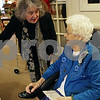 Rob Winner – rwinner@shawmedia.com<br /> <br /> Laura Halker (left) wishes Marie McKenzie a happy 100th birthday and gives her a card at the Grand Victorian in Sycamore on Monday, Dec. 30, 2013. While McKenzie's birthday was actually on December 29, she celebrated with residents and staff on Monday afternoon.