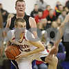 Rob Winner – rwinner@shawmedia.com<br /> <br /> Indian Creek's David Boehne controls a rebound under the Hinckley-Big Rock basket during the first quarter of a tournament game at the Plano Christmas Classic on Monday, December 30, 2013. IC defeated H-BR, 61-37.