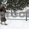 Rob Winner – rwinner@shawmedia.com<br /> <br /> Beverly Smith of DeKalb walks past the Ellwood House along North First Street using walking poles. After over indulging in holiday foods, Smith was hoping the exercise would help.