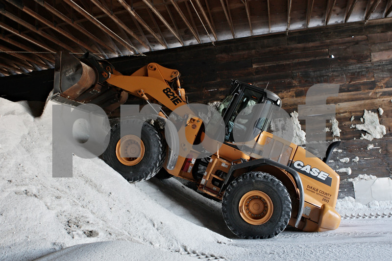 Rob Winner – rwinner@shawmedia.com<br /> <br /> Gene Capes uses a front end loader to pile up salt at the DeKalb County Highway Department in DeKalb, Ill., Tuesday, Dec. 31, 2013.