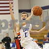 Rob Winner – rwinner@shawmedia.com<br /> <br /> Genoa-Kingston's Tommy Hansen puts up a shot in the first quarter during a tournament game against Forreston at the Plano Christmas Classic on Saturday, Dec. 28, 2013. G-K defeated Forreston, 43-42.