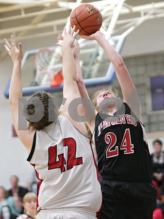 Rob Winner – rwinner@shawmedia.com<br /> <br /> Indian Creek's Josie Diehl (24) puts up two points with a shot over Amboy's Autumn Smith (42) in the second quarter during the Class 1A Hinckley-Big Rock Regional semifinal in Hinckley, Ill., Tuesday Feb.5, 2013.