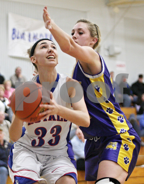 Rob Winner – rwinner@shawmedia.com<br /> <br /> Hinckley-Big Rock's Karrigan Cowan (33) looks to shoot before being fouled by Paw Paw's Josie Morgan (right) in the fourth quarter during the Class 1A Hinckley-Big Rock Regional semifinal in Hinckley, Ill., Tuesday Feb.5, 2013. H-BR defeated Paw Paw, 45-18.