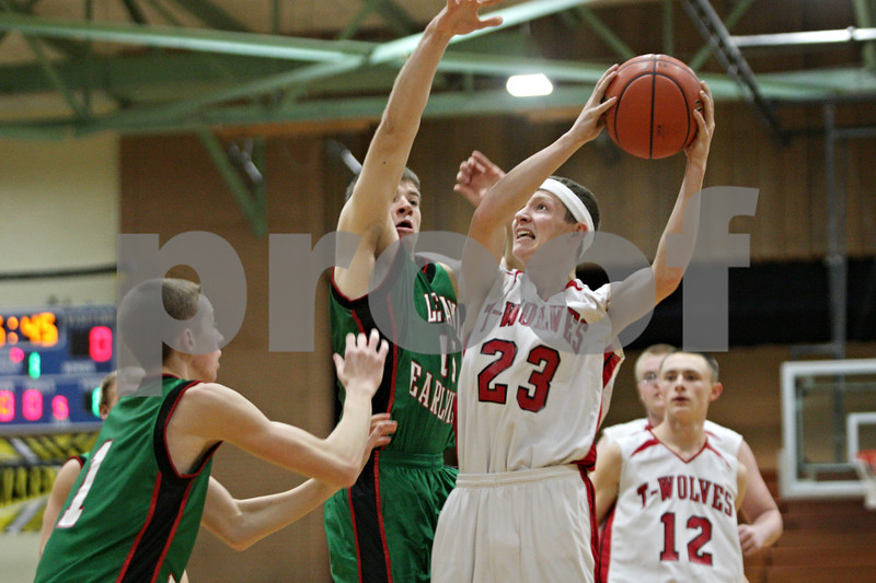 Rob Winner – rwinner@shawmedia.com<br /> <br /> Indian Creek's Tyler Reynolds (23) takes a shot in the first quarter during a game against Leland-Earlville at the Little Ten Conference tournament in Somonauk, Ill., Monday, Jan. 28, 2013.