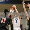 Rob Winner – rwinner@shawmedia.com<br /> <br /> Genoa-Kingston's Adam Price (12) puts up a shot good for two points during the first quarter in Genoa, Ill., Tuesday, Jan. 29, 2013. G-K defeated Byron, 47-43.