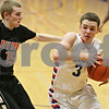 Rob Winner – rwinner@shawmedia.com<br /> <br /> Byron's Tyler Nunez (15) fouls Genoa-Kingston's Tommy Lucca (3) during the third quarter in Genoa, Ill., Tuesday, Jan. 29, 2013. G-K defeated Byron, 47-43.