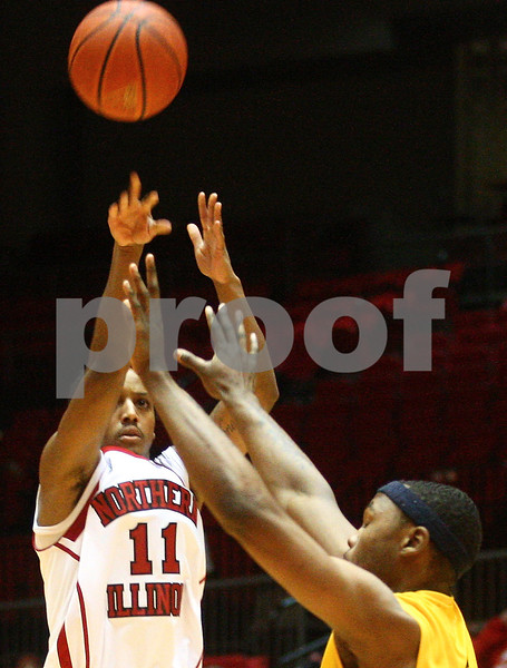 Kyle Bursaw – kbursaw@shawmedia.com<br /> <br /> Northern Illinois guard Daveon Balls (11) takes a shot during the first half of the game against Kent State at the Convocation Center in DeKalb, Ill. on Wednesday, Jan. 30, 2013.