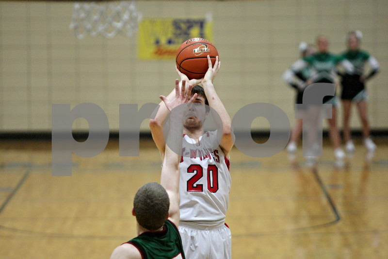 Rob Winner – rwinner@shawmedia.com<br /> <br /> Indian Creek's Stephen Muetze (20) takes a shot in the fourth quarter during a game against Leland-Earlville at the Little Ten Conference tournament in Somonauk, Ill., Monday, Jan. 28, 2013.