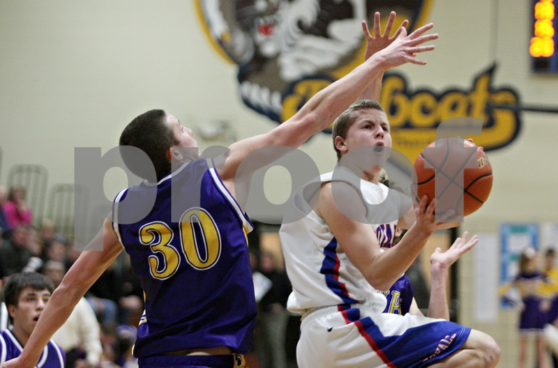 Rob Winner – rwinner@shawmedia.com<br /> <br /> Hinckley-Big Rock's Andrew Klambauer (right) takes a shot in the fourth quarter during the Little Ten Conference tournament against Paw Paw in Somonauk, Ill., Thursday, Jan. 31, 2013. H-BR defeated Paw Paw, 58-47.