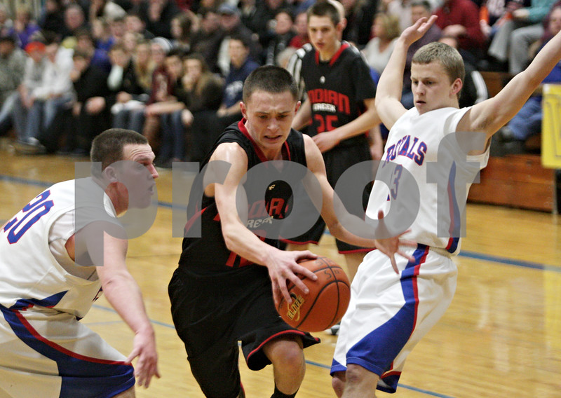 Rob Winner – rwinner@shawmedia.com<br /> <br /> Indian Creek's Kyle Lieving (center) is fouled by Hinckley-Big Rock's Andrew Klambauer (13) while driving to the basket in the second quarter during the Little 10 Conference tournament final in Somonauk, Ill., Friday Feb. 1, 2013