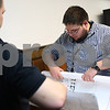 Kyle Bursaw – kbursaw@shawmedia.com<br /> <br /> DeKalb Public Library employees Patrick Smith (left) and Josh McCarthy roll up plans for the library's expansion on Thursday, Jan. 24, 2013, the plans were on the wall from a meeting earlier in the week.