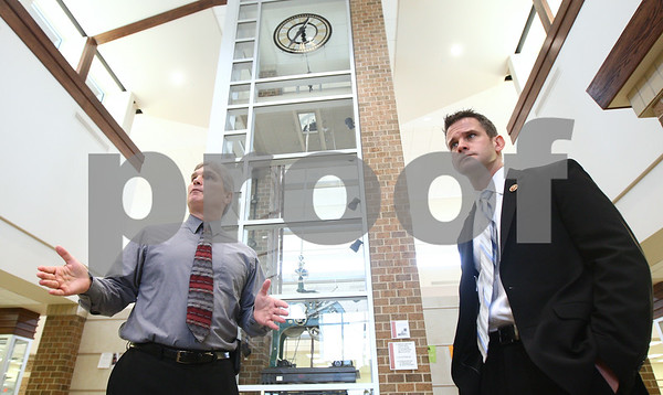 Kyle Bursaw – kbursaw@shawmedia.com<br /> <br /> District 428 Superintendent Jim Briscoe begins a tour of DeKalb High School for US Rep. Adam Kinzinger (right) on Monday, Jan. 28, 2013 with the high school's clock tower just inside the school's front entrance, a refurbished clock tower that was built for the original DeKalb High School.