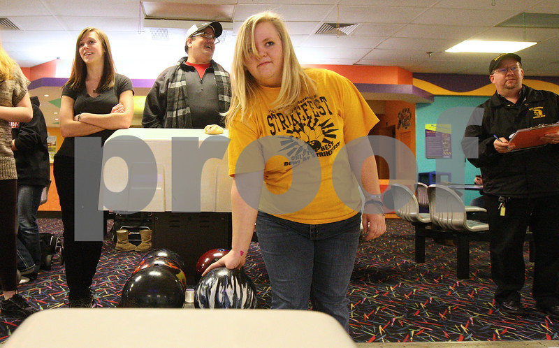 Kyle Bursaw – kbursaw@shawmedia.com<br /> <br /> Sycamore's Kayla Webb (center) grabs her ball as her turn comes up in practice at Mardi Gras Lanes on Friday, Feb. 1, 2013.