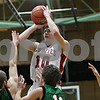 Rob Winner – rwinner@shawmedia.com<br /> <br /> Indian Creek's Jaron Todd (10) takes a shot in the first quarter during a game against Leland-Earlville at the Little Ten Conference tournament in Somonauk, Ill., Monday, Jan. 28, 2013.