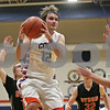 Rob Winner – rwinner@shawmedia.com<br /> <br /> Genoa-Kingston's Adam Price (12) jumps up for a pass before taking a shot for two points during the second quarter in Genoa, Ill., Tuesday, Jan. 29, 2013. G-K defeated Byron, 47-43.
