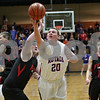 Rob Winner – rwinner@shawmedia.com<br /> <br /> Hinckley-Big Rock's Zach Michels (20) puts up a shot good for two points in the first quarter during the Little 10 Conference tournament final in Somonauk, Ill., Friday Feb. 1, 2013