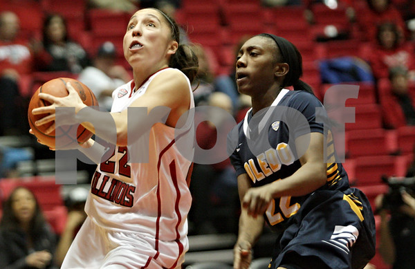 Rob Winner – rwinner@shawmedia.com<br /> <br /> Northern Illinois' Amanda Corral (left) goes to the basket for two points while being trailed by Toledo's Andola Dortch during the second half in DeKalb, Ill., Saturday, Jan. 26, 2013. Toledo defeated NIU, 44-42.