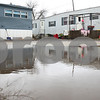 Kyle Bursaw – kbursaw@shawmedia.com<br /> <br /> A large puddle in the road reflects trailers at Evergreen Village on Wednesday, Jan. 30, 2013.