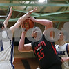 Rob Winner – rwinner@shawmedia.com<br /> <br /> Indian Creek's Garrison Govig (55) tries to take a shot while being pressured by two Newark defenders in the third quarter during the Little Ten Conference tournament in Somonauk, Ill., Thursday, Jan. 31, 2013. Indian Creek defeated Newark, 58-57, in overtime.