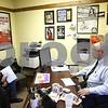 Kyle Bursaw – kbursaw@shawmedia.com<br /> <br /> John Saponari, the franchise general manager at Jackson Hewitt in DeKalb, finishes up tax returns for clients Maria and Jose Secena on Thursday, Jan. 24, 2013.