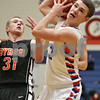 Rob Winner – rwinner@shawmedia.com<br /> <br /> Genoa-Kingston's Tommy Lucca (3) is fouled by Byron's Jacob Ferrell (31) during the second quarter in Genoa, Ill., Tuesday, Jan. 29, 2013. G-K defeated Byron, 47-43.