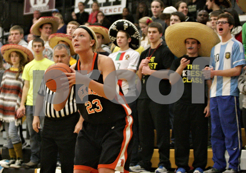 Rob Winner – rwinner@shawmedia.com<br /> <br /> DeKalb's Madelyne Johnson (23) looks to the basket before putting up a shot for three points in the second quarter in Sycamore, Ill., Thursday, Feb. 7, 2013. DeKalb defeated Sycamore, 50-26.