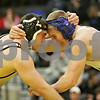 Rob Winner – rwinner@shawmedia.com<br /> <br /> Sycamore's Ren Swick (left) competes against Burlington Central's Craig Kein during their 170-pound finals match at the Class 2A Sycamore Regional on Saturday, Feb. 2, 2013. Swick won with a pin.