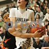 Rob Winner – rwinner@shawmedia.com<br /> <br /> DeKalb's Rudy Lopez (left) fouls Kaneland's John Pruett (5) in the second quarter during their game in Maple Park, Ill., Friday, Feb. 8, 2013. DeKalb defeated Kaneland, 50-45.