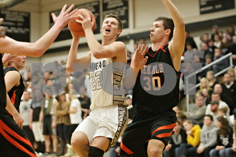 Rob Winner – rwinner@shawmedia.com<br /> <br /> Kaneland's Dan Miller (22) looks to take a shot in the second quarter during a game against DeKalb in Maple Park, Ill., Friday, Feb. 8, 2013. DeKalb defeated Kaneland, 50-45.